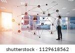 elegant businessman in 3d... | Shutterstock . vector #1129618562