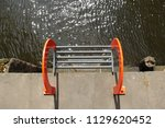quayside ladder leading to the...   Shutterstock . vector #1129620452