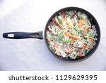 mixture of frozen vegetables in ...   Shutterstock . vector #1129629395