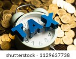 time to pay tax concept. tax... | Shutterstock . vector #1129637738