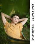 Teenager Boy Resting In Hammock ...