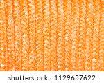 orange wicker background. close ...   Shutterstock . vector #1129657622