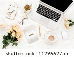 female workspace with laptop ... | Shutterstock . vector #1129662755