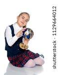 beautiful little schoolgirl... | Shutterstock . vector #1129664012