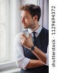 handsome business man enjoying... | Shutterstock . vector #1129694372