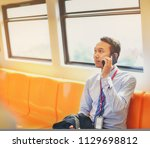 an asian businessman is... | Shutterstock . vector #1129698812