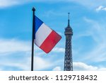 french flag waving against blue ... | Shutterstock . vector #1129718432