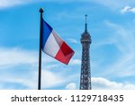 french flag waving against blue ... | Shutterstock . vector #1129718435