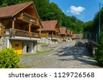 a series of wooden cottages on...   Shutterstock . vector #1129726568