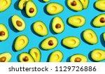 fresh avocado pattern on a blue ... | Shutterstock . vector #1129726886