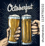 hands holding and clinking beer ... | Shutterstock .eps vector #1129750232