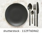 black silverware and empty... | Shutterstock . vector #1129760462