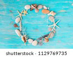 circle of sea shells with copy... | Shutterstock . vector #1129769735