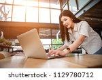close up the hand of an asian... | Shutterstock . vector #1129780712