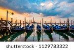 gondola service tourist people... | Shutterstock . vector #1129783322