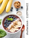acai blueberry smoothie bowl... | Shutterstock . vector #1129786622