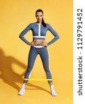 attractive sportswoman performs ...   Shutterstock . vector #1129791452