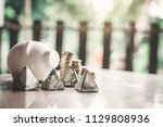 white piggy bank and coin on...   Shutterstock . vector #1129808936