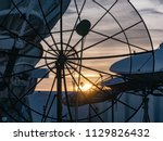 digital tv satellite dish | Shutterstock . vector #1129826432