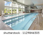 view of indoor swimming pool in ... | Shutterstock . vector #1129846505