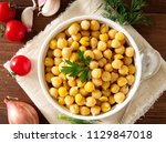 cooked chickpeas on bowl on... | Shutterstock . vector #1129847018