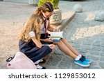 school children  girls of high... | Shutterstock . vector #1129853012