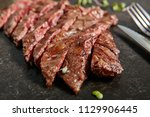 thick slices of hot grilled... | Shutterstock . vector #1129906445