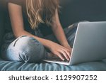 young woman sitting and writing ... | Shutterstock . vector #1129907252