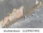 a damaged house wall and flaked ... | Shutterstock . vector #1129907492