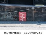 draft marks for a transport ship | Shutterstock . vector #1129909256