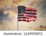 American Flag Waving In The Sk...