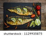fried mackerel fillets on... | Shutterstock . vector #1129935875