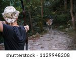 hunter with an arrow aimed at a ... | Shutterstock . vector #1129948208