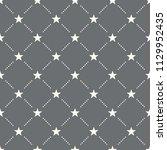 seamless star pattern on a dark ... | Shutterstock .eps vector #1129952435