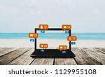 computer laptop on wooden table ... | Shutterstock . vector #1129955108