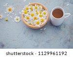 chamomile tea with fresh... | Shutterstock . vector #1129961192