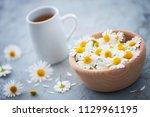 chamomile tea with fresh... | Shutterstock . vector #1129961195
