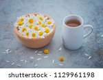 chamomile tea with fresh... | Shutterstock . vector #1129961198