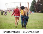 group of friends at summer... | Shutterstock . vector #1129966235