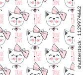 fashion cat seamless pattern.... | Shutterstock .eps vector #1129974662