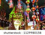 lijiang ancient city store ... | Shutterstock . vector #1129980158