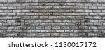 brick wall of decorative gray... | Shutterstock . vector #1130017172