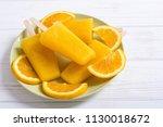 homemade orange popsicle .... | Shutterstock . vector #1130018672