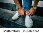 leg woman wear white sneakers... | Shutterstock . vector #1130026265