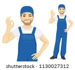 man in blue overalls gesturing... | Shutterstock .eps vector #1130027312