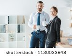 cheerful accountants holding... | Shutterstock . vector #1130033648