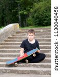 A Teenager With A Skateboard....