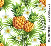 pineapples with palm leaves.... | Shutterstock .eps vector #1130051228