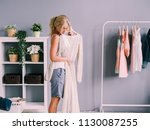 woman in wardrobe with new dress | Shutterstock . vector #1130087255