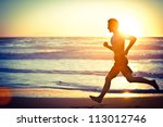 man running on the beach at... | Shutterstock . vector #113012746